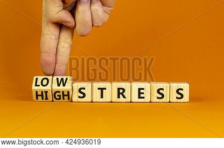 Low Or High Stress Level Symbol. Businessman Turns Wooden Cubes And Changes Words High Stress To Low