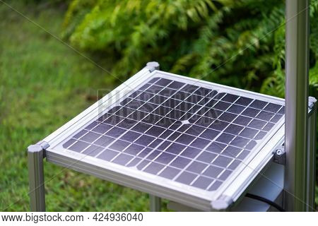 New Solar Cell Is Laid Down Among Tree Plant In The Garden.