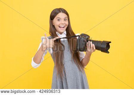 Advertisement. Photographer Beginner With Modern Camera. Making Video. Childhood.