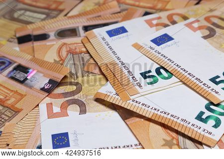 Background Of Fifty Euro Banknotes. Soft Focus