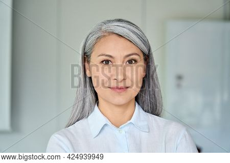 Happy Confident Middle Aged Asian Older Senior Female Lawyer Businesswoman Corporation Ceo In Modern