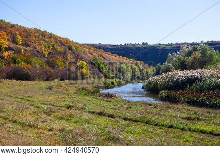 Picturesque Nature With River . Brook Flowing Between The Hills