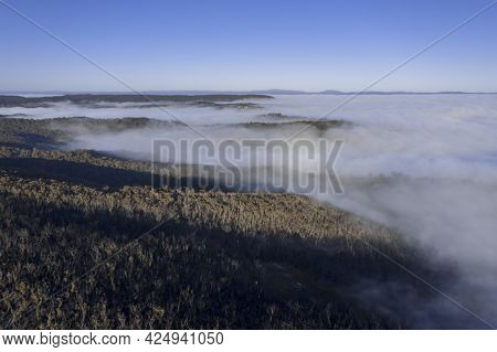 Drone Aerial Photograph Of Fog In A Large Valley In The Blue Mountains In New South Wales In Regiona