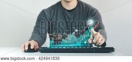 Businessman Working In Modern Office, Technical Price Chart And Red And Green Candlestick Chart Indi