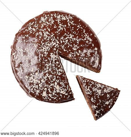 Round Glazed Cake Sprinkled With Coconut Flakes With Piece Cut Out Isolated On White Background. Top