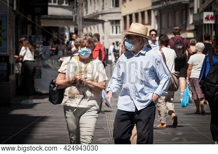 Ljubljana, Slovenia - June 15, 2021: Selective Blur On Old Senior Man And Woman, Couple, Wearing A F