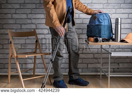 Man Hiker Getting Ready For Adventure At Home Or Hotel.
