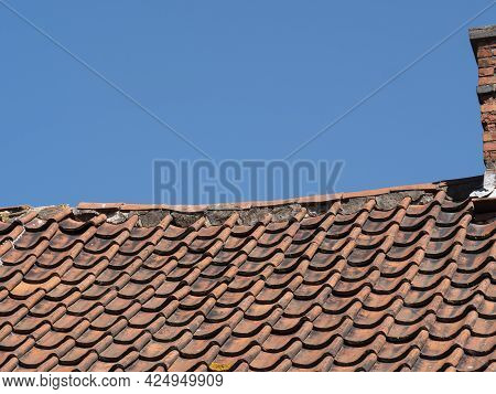 Roof With Red Roof Tiles That Is Sinking In The Middle