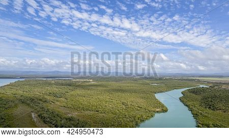 Aerial Over A Blue Water Creek To The Ocean Amongst A Mangrove Bushland Environment At Cape Palmerst