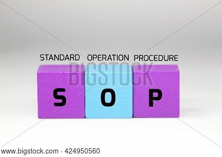 Colored Cubes With The Letters Sop And The Words Standard Operation Procedure