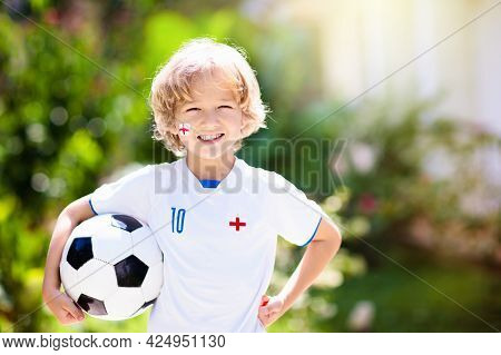 England Football Fan Cheering. Kids Play Soccer And Celebrate Victory On Outdoor Field. England Team