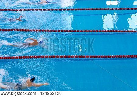 Children Swim In The Pool. Young Swimmers Competition. Unidentified Young Swimmers. Top View Shot. T