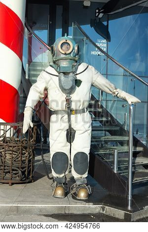 Deep-sea Scuba Suit At The Entrance To The Cafe On The Waterfront