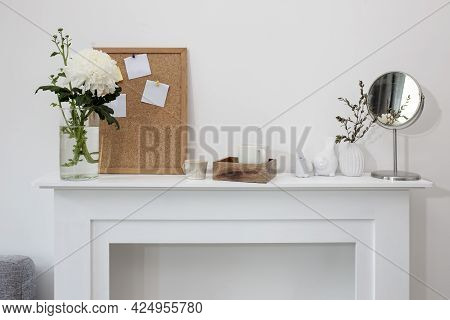 A Chrysanthemum In A Transparent Vase, A Cork Board With Empty Leaves, A Wooden Tray With A Cup Of C