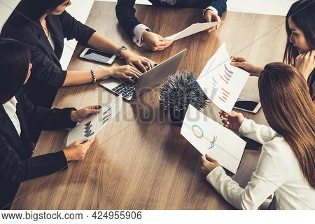Businesswoman In Group Meeting Discussion With Other Businesswomen Colleagues In Modern Workplace Of
