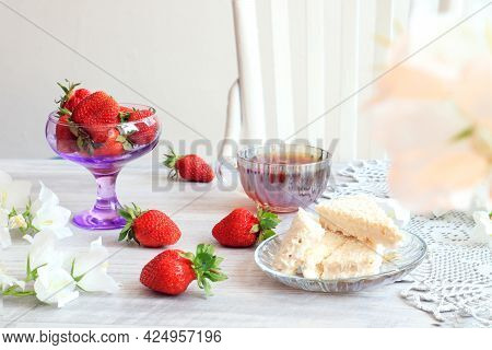 The Concept Of Good Morning. Ripe Strawberries, Airy Waffles, White Bells, A Cup Of Tea , A Gray Nap