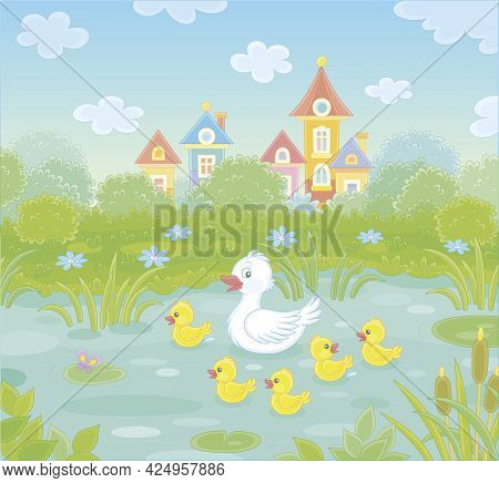 Cute White Duck And A Merry Brood Of Yellow Little Ducklings On A Pretty Pond Near A Small Colorful