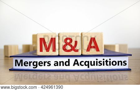 Mergers And Acquisitions Symbol. Concept Words 'm And A, Mergers And Acquisitions' On Wooden Cubes O