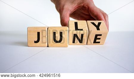 From June To July Symbol. Businessman Turns Wooden Cubes And Changes The Word 'june' To 'july'. Beau