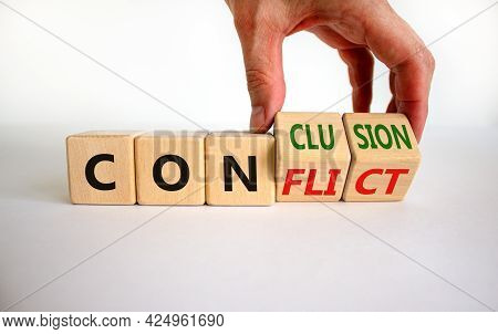 Conflict Or Conclusion Symbol. Businessman Turns Wooden Cubes And Changes The Word 'conflict' To 'co