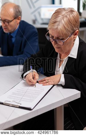 Woman Reading Financial Documents In Conference Room Before Signing It. Executive Director Meeting S