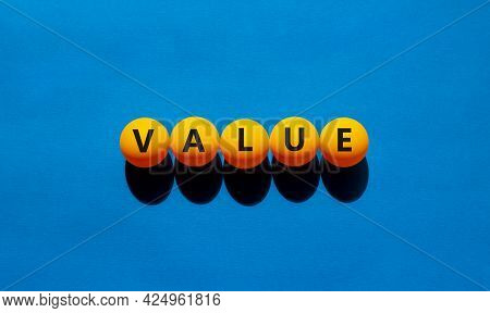 Value Symbol. Orange Table Tennis Balls With The Words 'value'. Beautiful Blue Background, Copy Spac