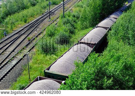 Railway Cargo Cars Loaded With Coal. Freight Train Transporting Coal, Wood, Fuel. Top View.