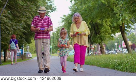 Senior Stylish Old Grandmother Grandfather Walking With Granddaughter Child Squeezing Presses Anti-s