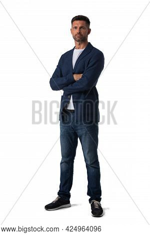 Full Length Portrait Of Mid Adult Serious Business Man In Jeans And Blue Blazer With Arms Folded Iso