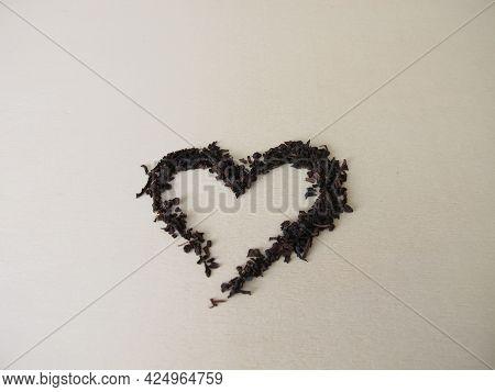 Loose Broken Black Tea On A Wooden Board