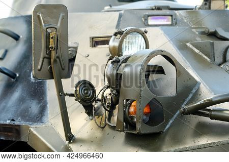 Headlights Of An Armored Combat Vehicle. Close-up Of Combat Military Equipment With Light Lights