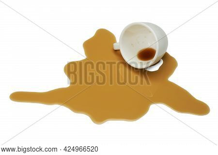 Overturned Cup And Spilled Coffee On White Background