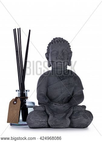 Grey Ceramic Buddha Statue, Standign Beside Glass Home Perfume Bottle With Wooden Sticks. Isolated O