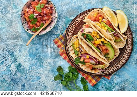 Mexican Tacos With Grilled Chicken, Avocado, Corn Kernels, Tomato, Onion, Cilantro And Salsa At Blue