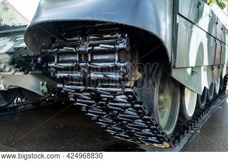Tracked Armor Close-up. Black Tracks And Large Rubberized Rollers. Tank Chassis