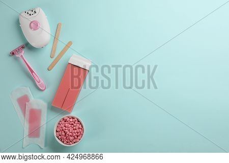 Set Of Epilation Tools And Products On Turquoise Background, Flat Lay. Space For Text