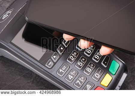 Credit Card Reader And Mobile Phone Using For Cashless Paying. Payment Terminal. Finance And Banking