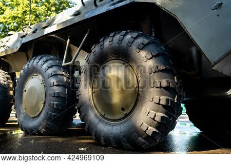 Close-up Of The Large Wheels Of A Combat Vehicle.military Concept