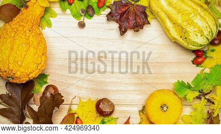 Autumn Leaves Fall. Natural Harvest With Orange Pumpkin, Fall Dried Leaves, Red Berries And Acorns,