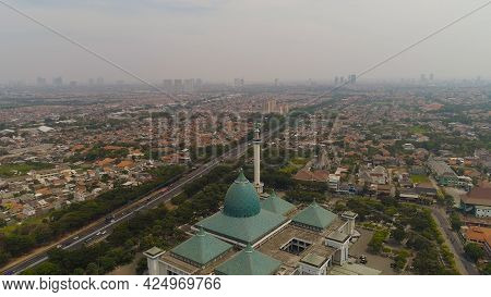 Aerial View Cityscape City Surabaya With Mosque Al Akbar, Highway, Skyscrapers, Buildings And Houses