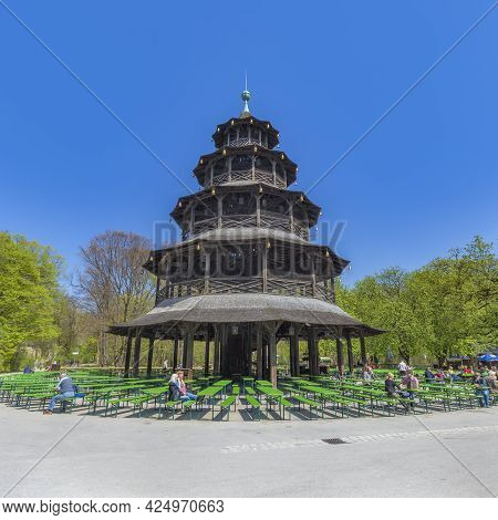 Munich, Germany - April 20, 2015: : People Enjoy The  Biergarten Near Chinese Tower In English Garde