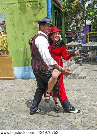 Buenos Aires, Argentina - Jan 26, 2015: Tango Dancer Pose For Tourists In Caminito Street, Buenos Ai