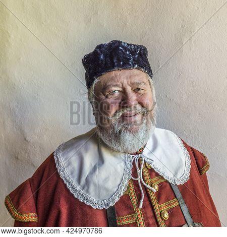 Rothenburg, Germany - April 19, 2015: Old Man Dressed In Medieval Clothes In Rothenburg, Germany. Es