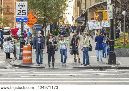 New York, Usa - October 21, 2015:  People At Central Park West In New York Wait For Green Traffic Li