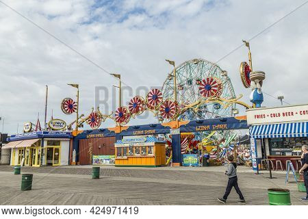 Coney Island, Usa - Oct 25, 2015: People Visit Famous Old Promenade At Coney Island, The Amusement B