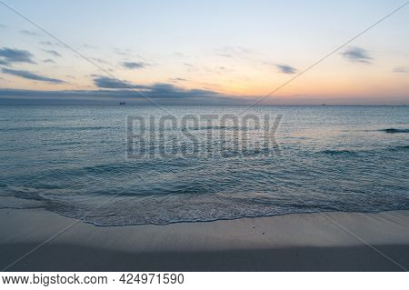 Ocean Sunset On Sea Water With Sunset Sky And Silhouettes Of Ship. Seascape Sunrise Over The Sea.