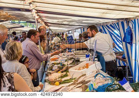 Paris, France - June 13, 2015: People Buy Fresh Fish At Street Market In Chaillot, Paris, France. At