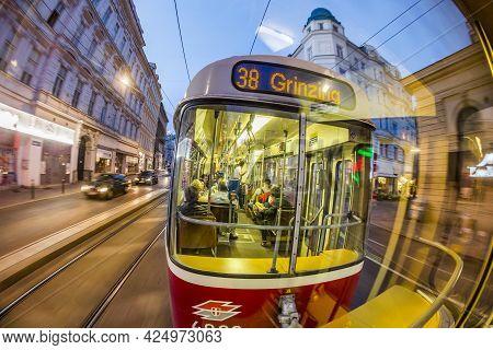 Vienna, Austria - April 25, 2015:  Old Fashioned Tram By A Night Ride In Vienna, Austria. Vienna Has
