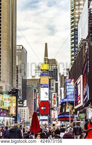 New York, Usa - Oct 21, 2015: People Visit Times Square, Featured With Broadway Theaters And Huge Nu
