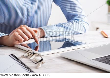 Business Lady Sitting At Desk With Tablet Computer. Corporate Office Workplace With Laptop. Mobile S